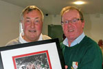 Stephen Laverick recieving a signed limited edition print of Charlie Hurley, Len Ashurst & Monty